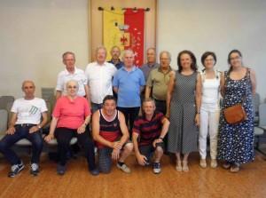 Nella foto di gruppo l'assessore Luisa Benedini (seconda da destra) con la funzionaria comunale che coordina il servizio e alcuni accompagnatori volontari che si sono incontrati in settimana per fare il punto del lavoro svolto durante l'anno scolastico appena concluso
